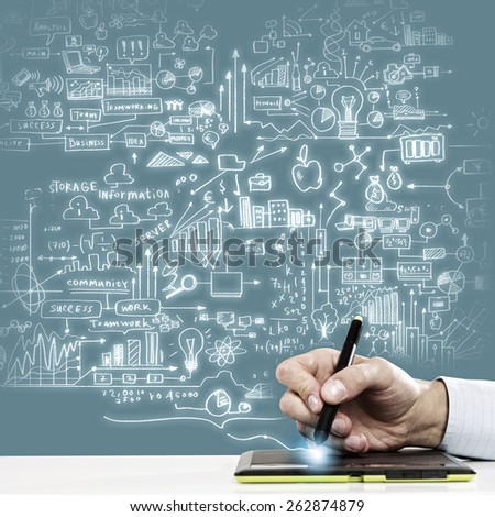 Close up of human hand drawing business strategy plan - stock photo