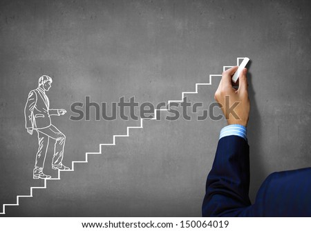 Close up of human hand drawing career ladder with chalk - stock photo