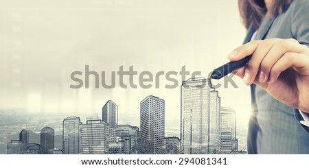 Close up of human hand drawing construction project - stock photo