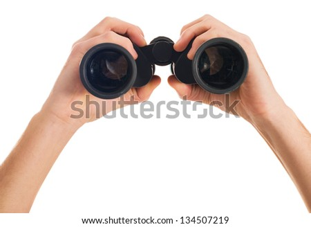Close-up Of Human Hand Holding Binoculars On White Backgrounds - stock photo