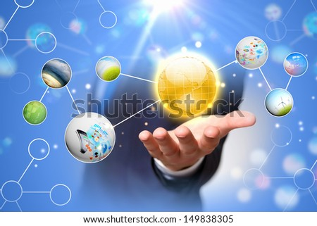 Close up of human hand holding globe image - stock photo