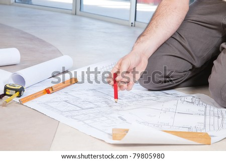 Close-up of human hand holding pencil on - stock photo