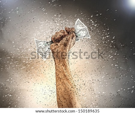Close-up of human hand in dirt clenching dollar banknote - stock photo