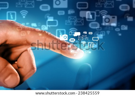 Close up of human hand touching screen of tablet