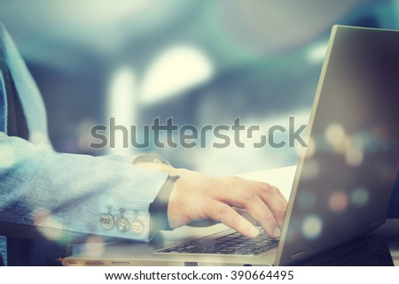 Close up of human hand with laptop - stock photo