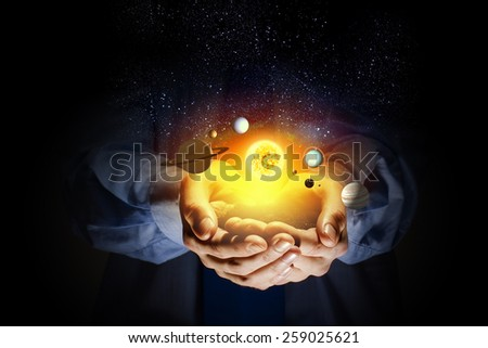 Close up of human hand with planet of sun system - stock photo
