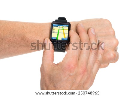 Close-up Of Human Hand With Smartwatch Showing Gps Map Direction - stock photo