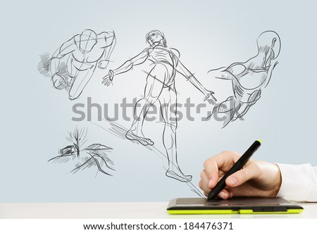 Close up of human hand working with tablet - stock photo