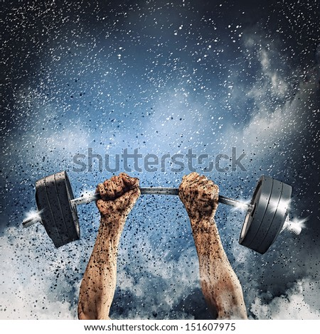 Close-up of human hands lifting up barbell - stock photo