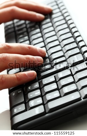 Close up of human hands on the keyboard - stock photo