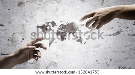 Close up of human hands touching with fingers. Based on Michelangelo picture. Elements of this image are furnished by NASA - stock photo