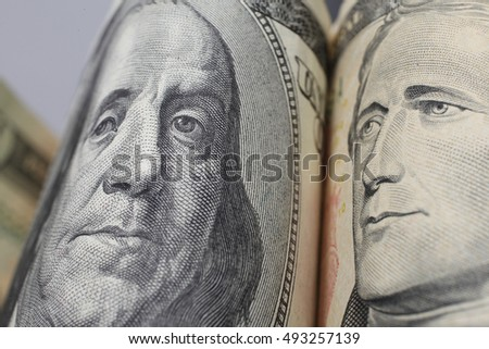 Close-up of hundred and ten dollars banknotes. Small DOF