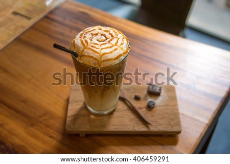 Close up of ice coffee with whip cream and caramel on top in cafe  tokyo japan. - stock photo