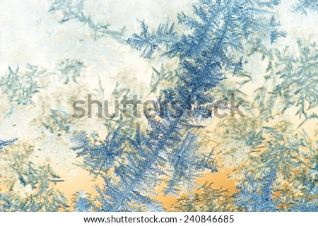 Close up of ice crystals on glass - stock photo