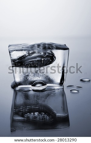 Close up of ice cube on grey background