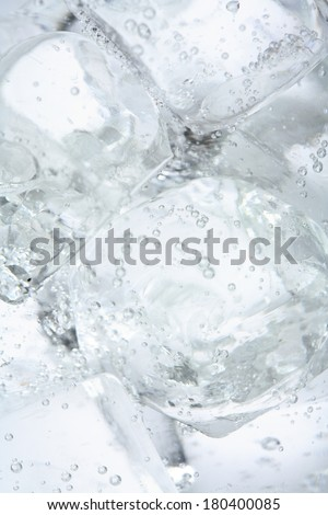 Close up of ice cubes in water  - stock photo