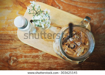 Close up of iced coffee. Shallow depth of field. Toned image.
