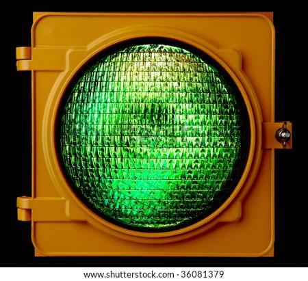 Close up of illuminated green traffic light lens - stock photo