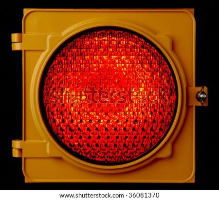 Close up of illuminated red traffic light lens - stock photo