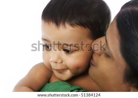 Close-up of Indian mother holding her lovely baby in her hands showing deep affection on white background. - stock photo