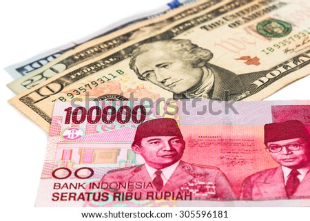 Close up of Indonesia Rupiah currency note against US Dollar. - stock photo