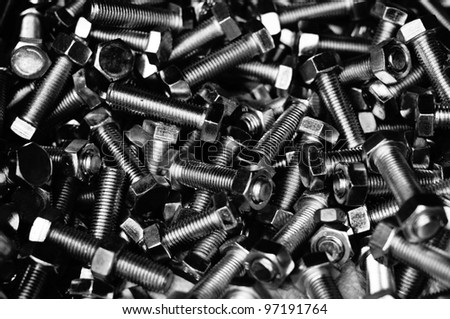 close up of industrial bolts and nuts in high contrast black and white - stock photo