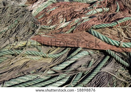 Close up of industrial fishing nets and ropes. - stock photo