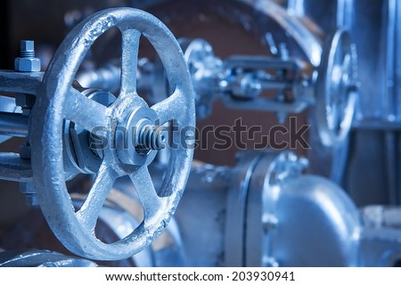 Close-up of industrial gate valve with focus on stem and nut of the hand wheel - stock photo