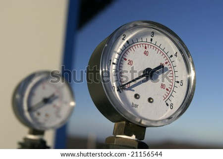 close up of industrial pipes and measure of compression - stock photo