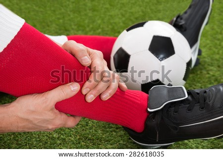 Close-up Of Injured Soccer Player On Field - stock photo