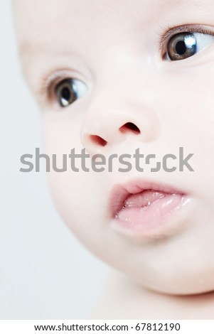 close up of innocent baby - stock photo