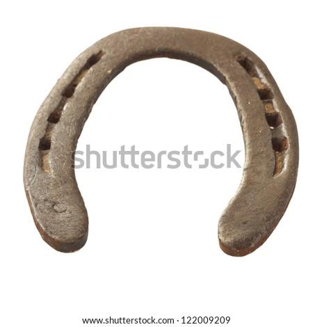 Close up of iron horseshoe isolated over white background - stock photo