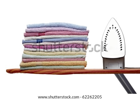 close up of ironing tool and towels on white background - stock photo