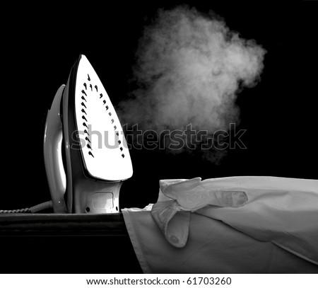 close up of ironing tool  on white background - stock photo