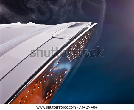 close up of ironing tool with steam on blue - stock photo