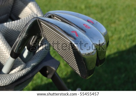 Close up of 7, 8, & 9 Irons (Clubs) in a Golf Bag - stock photo