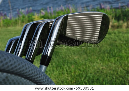 Close up of Irons (Clubs) in a Golf Bag - stock photo