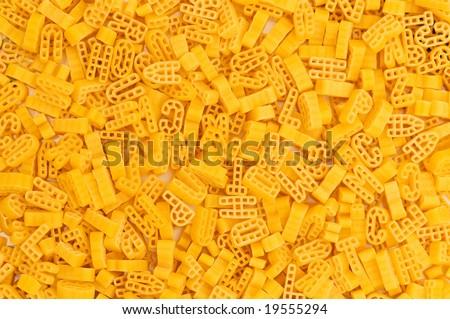 Close up of italian pasta - alphabet shaped - stock photo