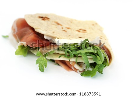 close up of italian typical sandwich with ham on white background - stock photo