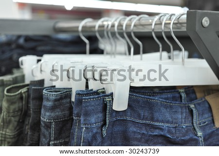 Close up of jeans on a rack - stock photo