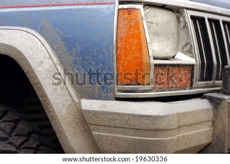 close up of jeep covered with mud - stock photo