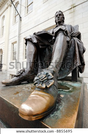 Close-up of John Harvard statue's polished shoe. Tourists, and aspiring students from all over the world, keep rubbing it for good luck. - stock photo