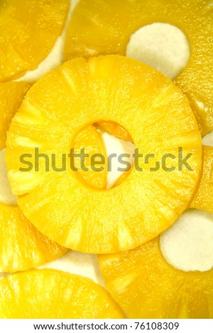 Close-up of juicy yellow pineapple slices - stock photo