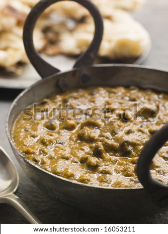 Close up of Kali Dahl Served in a Karahi With Naan Bread