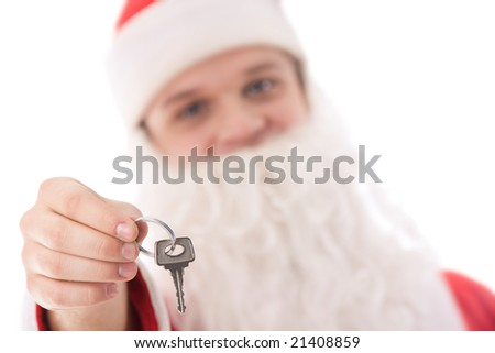 Close-up of key from new flat in Santa?s hand on background of his face - stock photo