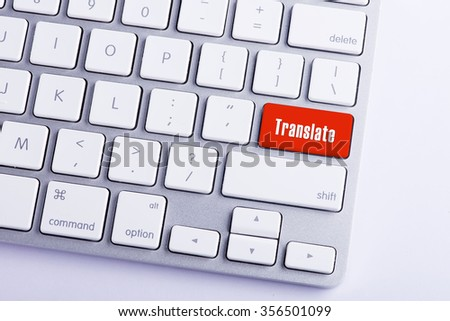 Close up of keyboard and translate word key in red color