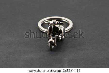 Close up of keychain motorbike over black - stock photo