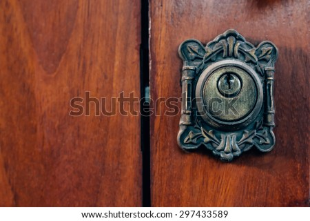 Close up of keyhole on wooden door vintage style - stock photo