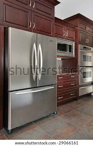 Close up of kitchen cabinets and refrigerator - stock photo