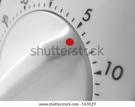 Close up of kitchen timer set to 5 minutes to go - stock photo
